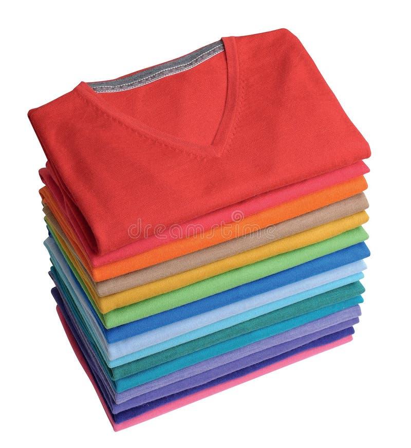 Stapel van kleurrijke t-shirts stock foto's