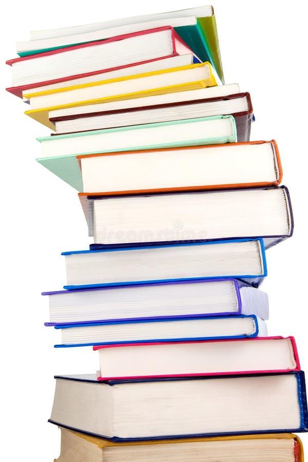Stapel van nieuwe boeken die op wit worden geïsoleerdo stock afbeelding