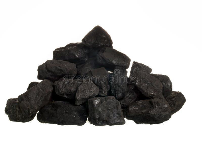 Stapel van steenkool op witte achtergrond stock fotografie