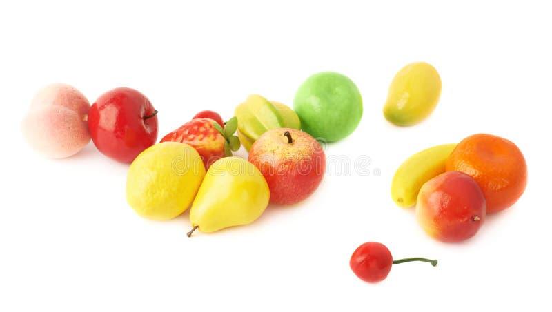 Stapel van veelvoudige kunstmatige plastic vruchten en stock fotografie