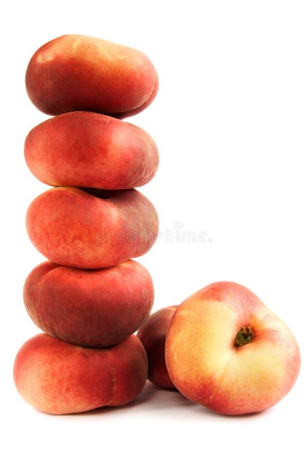Stapel van vlakke perziken royalty-vrije stock afbeelding