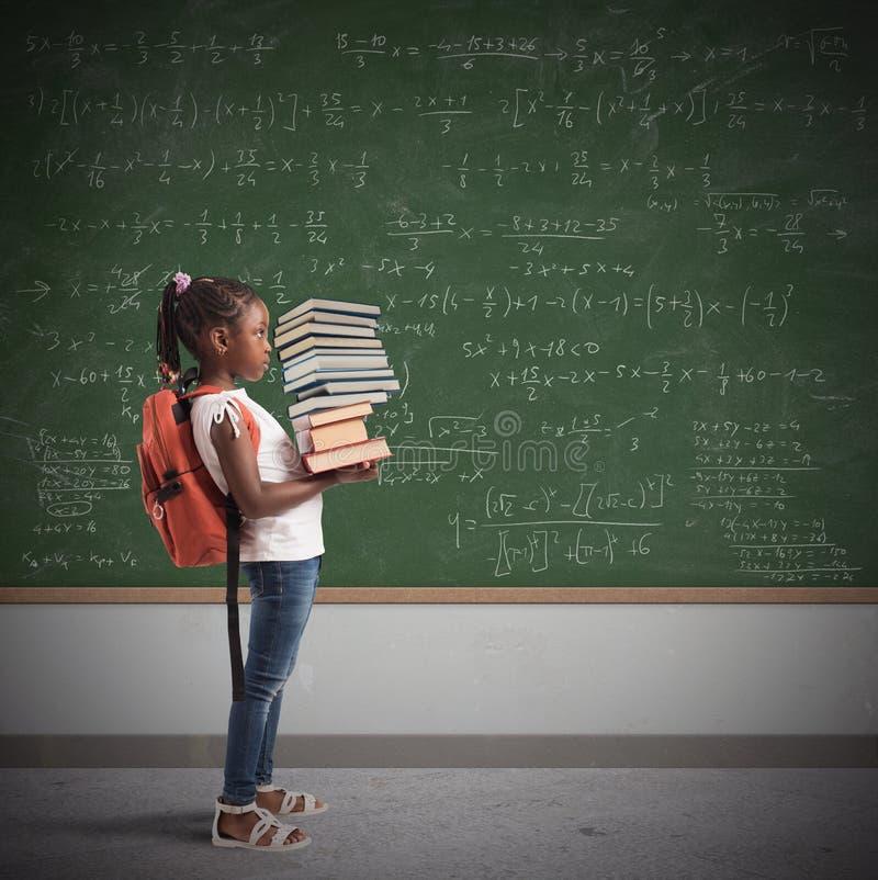 Stapel van wiskundeboeken voor een kind royalty-vrije stock afbeelding