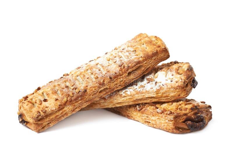 Stapel van zoete geïsoleerde gebakjebroodjes stock foto's