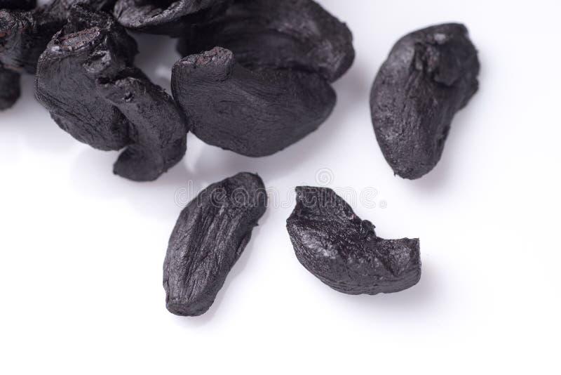 Stapel van Zwart Knoflook stock foto