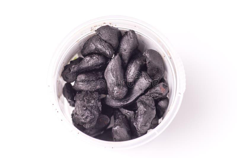 Stapel van Zwart Knoflook stock afbeeldingen