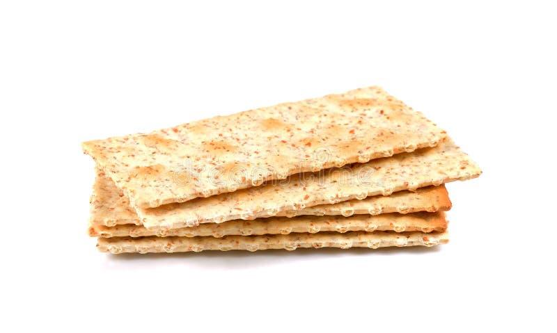Stapel vierkante crackers die op witte achtergrond worden geïsoleerd Droge barst royalty-vrije stock fotografie