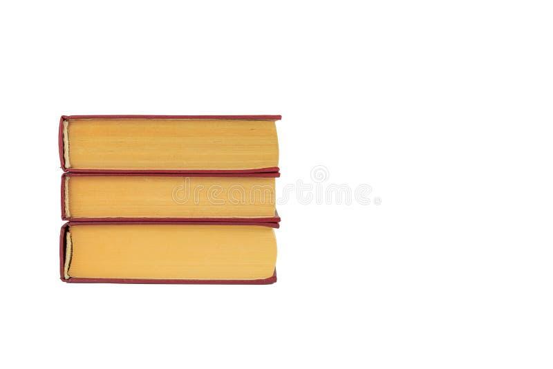 Stapel von drei Büchern auf einem weißen Hintergrund lizenzfreie stockfotos