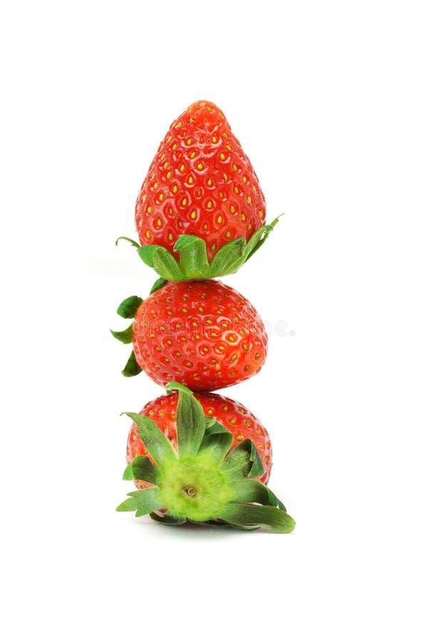 Stapel von drei Erdbeeren stockbild