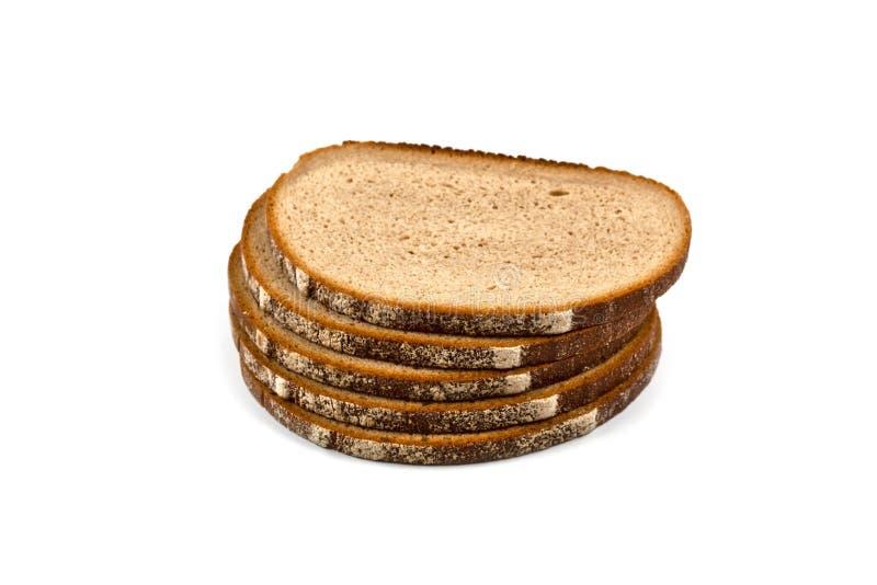 Stapel von fünf neuen gebackenen Brotscheiben lokalisiert auf Weiß lizenzfreie stockfotografie