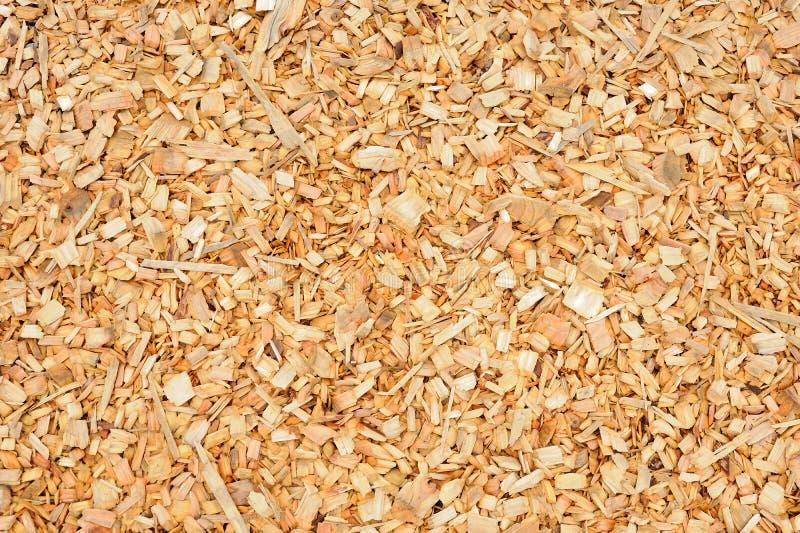 Stapel von Stückchen Schrottholzhintergrund lizenzfreie stockfotos