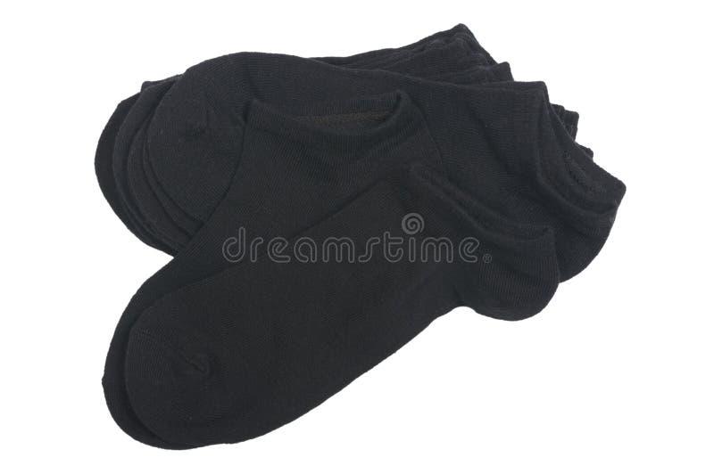 Stapel zwarte korte geïsoleerde sokken royalty-vrije stock afbeelding