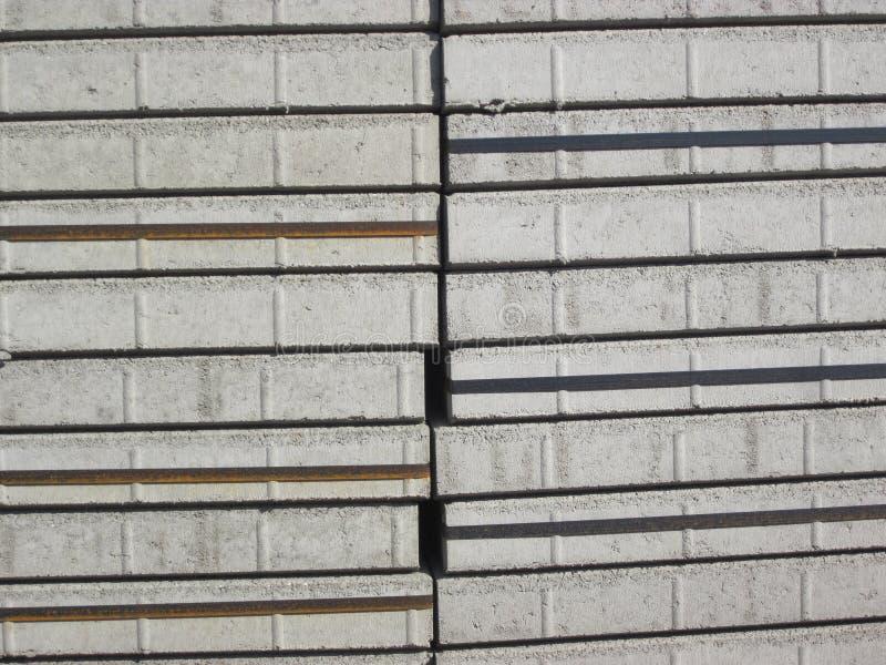 Stapels grijze pleisterstenen stock afbeeldingen