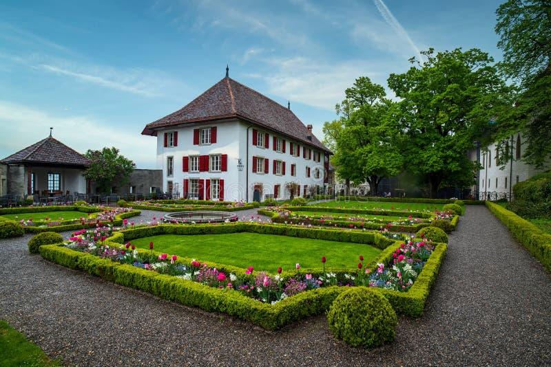 Stapfer House with baroque garden, Lenzburg, Switzerland. Stapfer House with baroque garden with blooming flowers at sunny spring day, Lenzburg, Switzerland stock photo