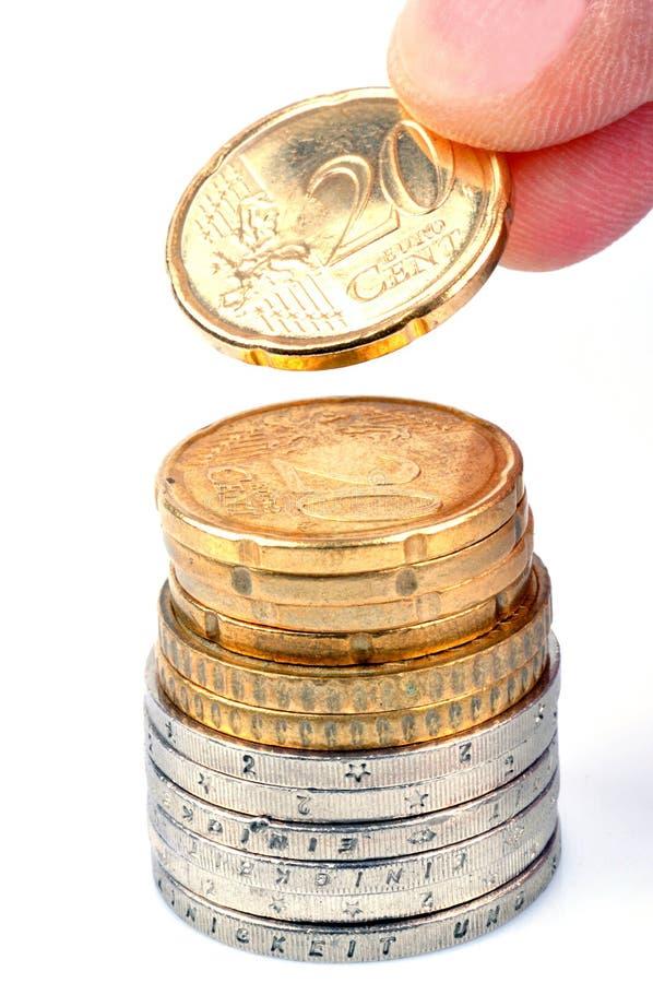 Stapla euromynt i closeup på vit bakgrund royaltyfri bild
