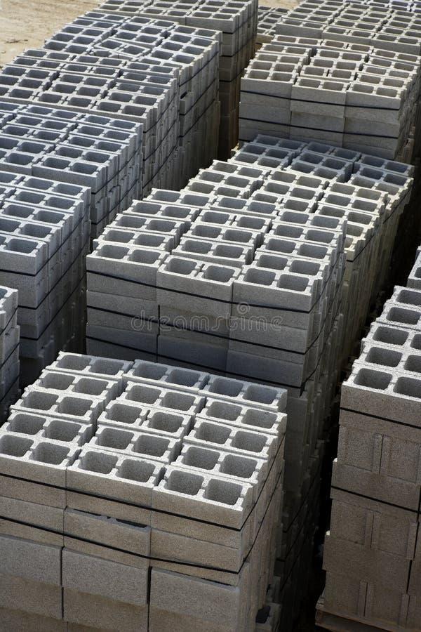 staplade staplar för blockkonstruktionsgran arkivfoto