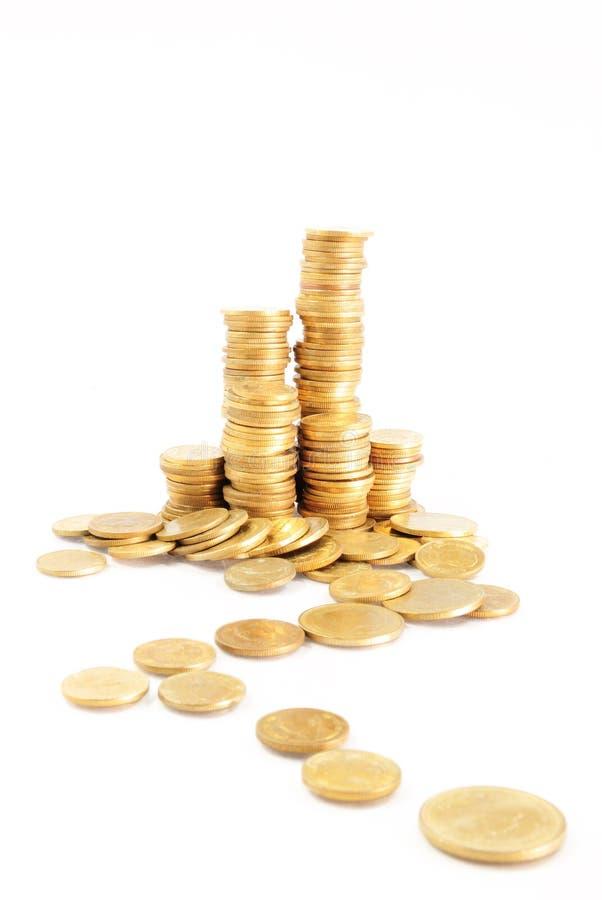 staplar för myntguld arkivfoton