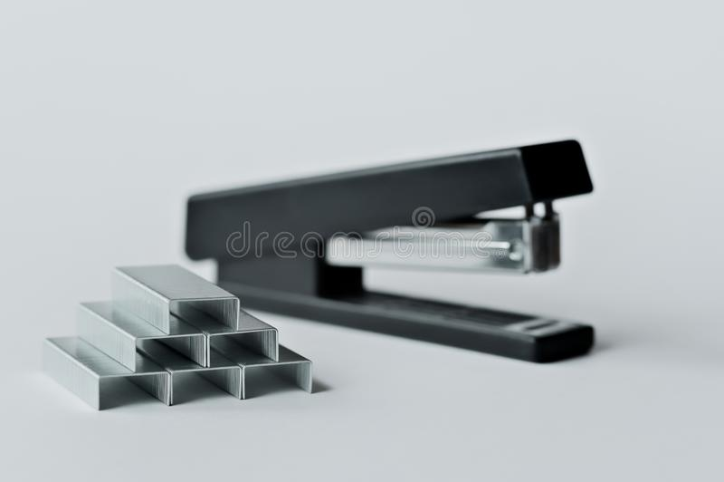 Stapler black with paper clips isolated on white background royalty free stock photography