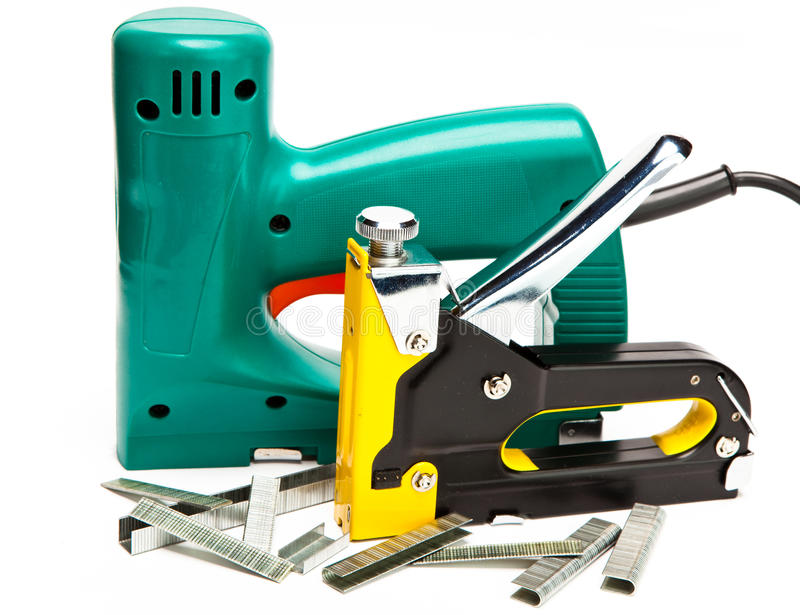 Staplers electrical and manual mechanical - for repair work in the house royalty free stock photo