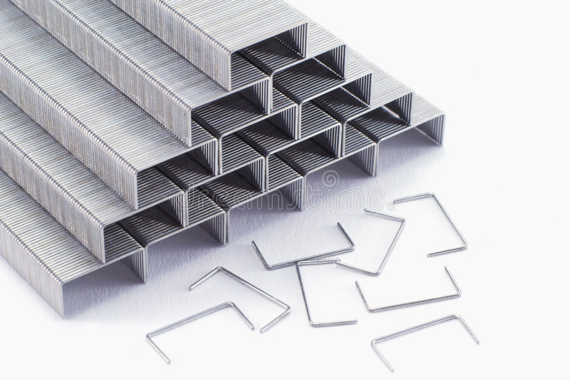 Staples. A collection of staples in the shape of a pyramid royalty free stock photo