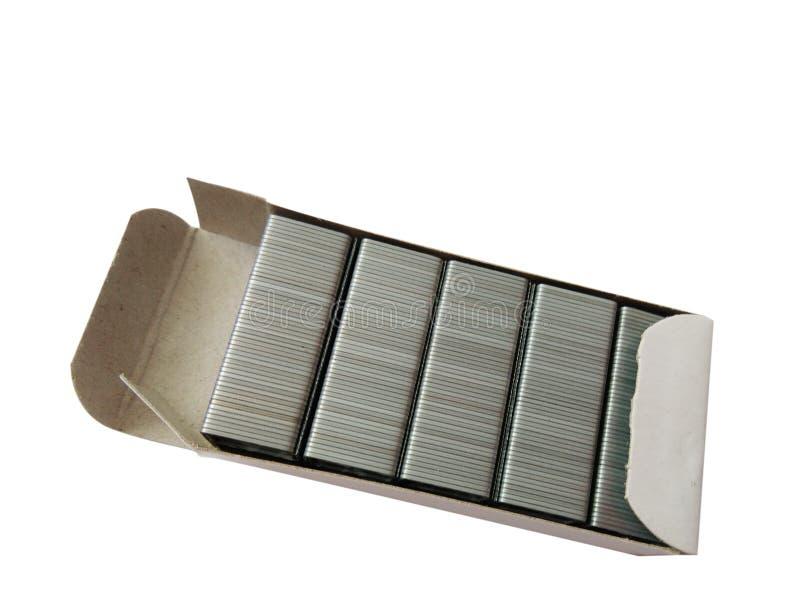 Staples en la caja de papel fotos de archivo libres de regalías