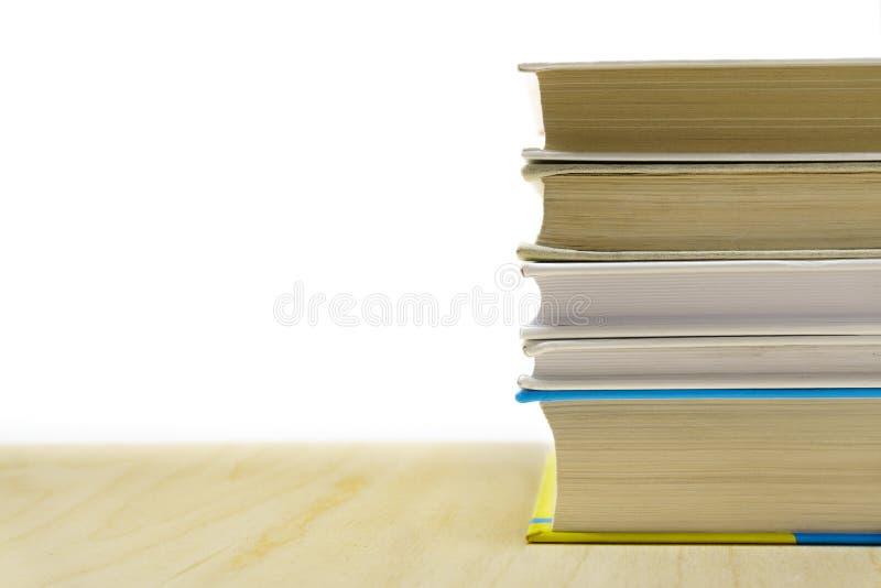 Stapling av böcker arkivbilder