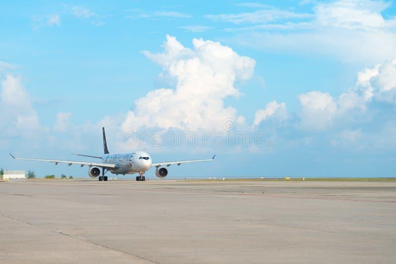Star alliance airplane of Thai Airways. PHUKET, THAILAND - 24 APR 17: Star Alliance airplane of Thai Airways is arriving in Phuket international airport stock photography