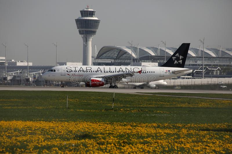 Austrian Airlines, Star Alliance doing taxi in Munich Airport, MUC. Star Alliance Austrian Airlines taxiing in Muenchen Airlines, MUC Germany royalty free stock images