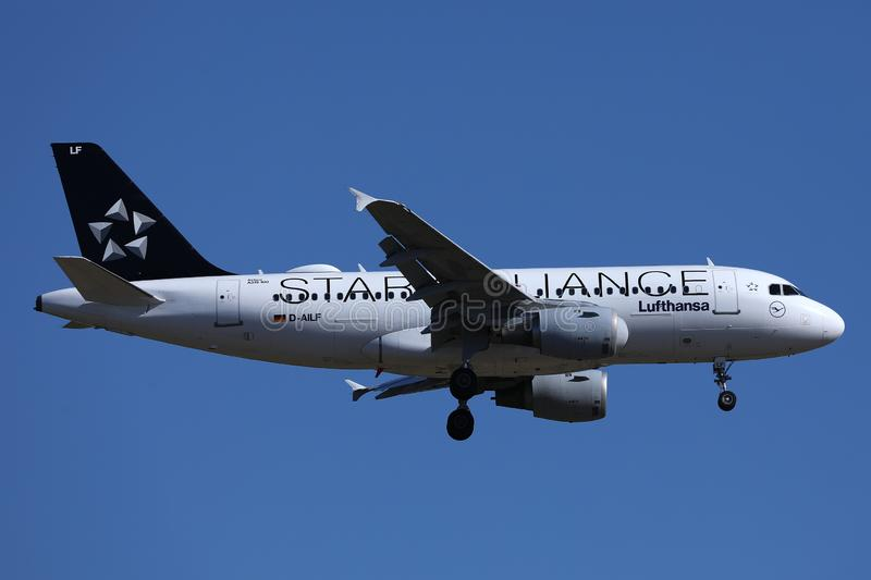 Star Alliance Lufthansa airplane flying up in the blue sky. Close-up view stock photos