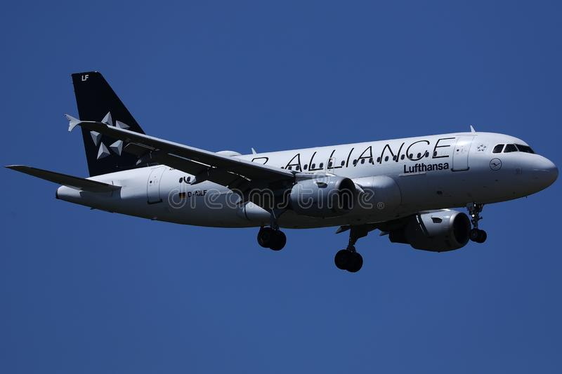 Star Alliance Lufthansa airplane flying up in the blue sky. Close-up view stock images