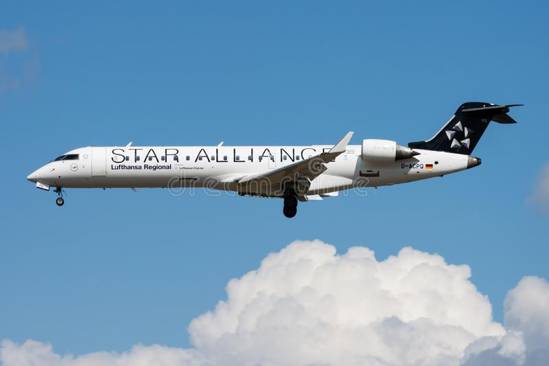 Star Alliance Lufthansa Regional Bombardier CRJ-700 D-ACPQ passenger plane landing at Frankfurt airport. FRANKFURT / GERMANY - AUGUST 12, 2014: Star Alliance royalty free stock images