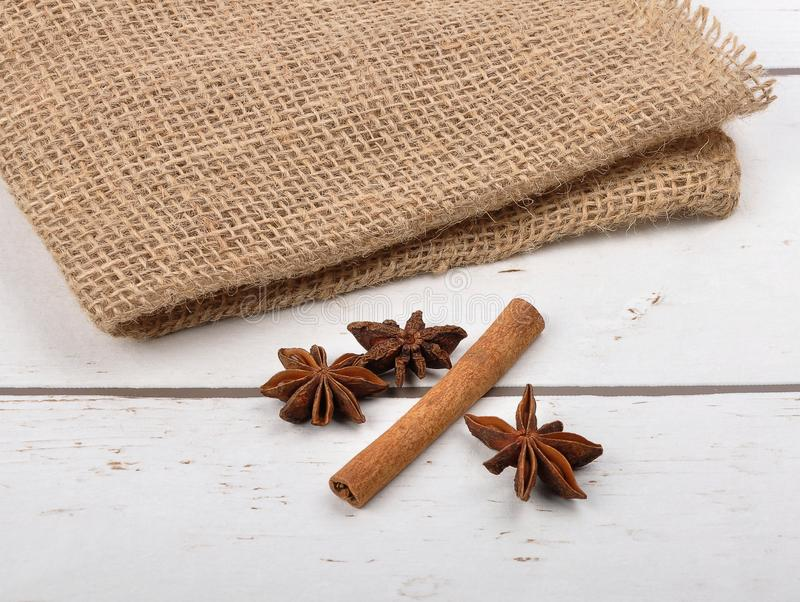Star anis and cinnamon stick on wood. Colorful and crisp image of star anis and cinnamon stick on wood stock photography