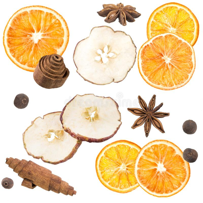 Star anise, black pepper, cinnamon, dried oranges and an apple on a white background. Dried oranges on a white background royalty free illustration