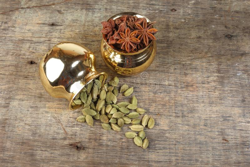 Star Anise Cardamom spice in golden metal pot stock photography