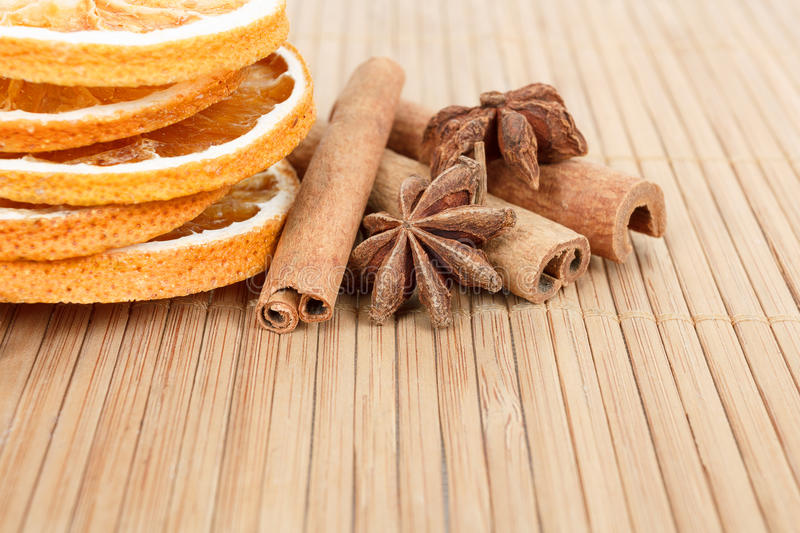 Star Anise, Cinnamon And Dried Orange Wooden Background Stock Photos