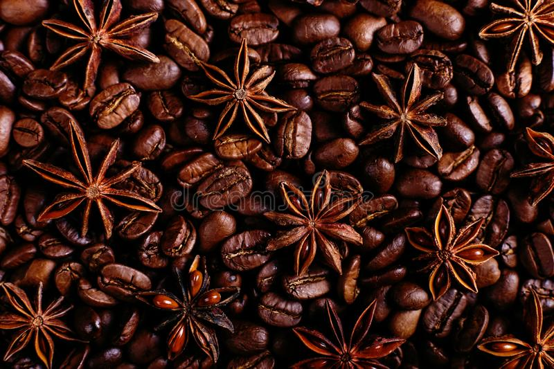 Star anise and coffee beans on the kitchen table. Fragrant spices for coffee drink, closeup background royalty free stock photo