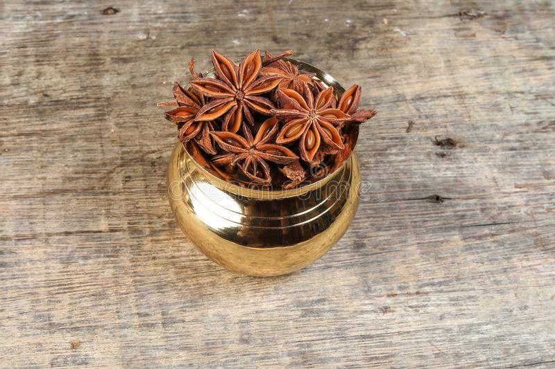 Star anise metal pot rustic wood stock images