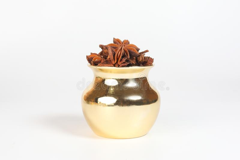 Star anise spice in shiny metal pot stock images