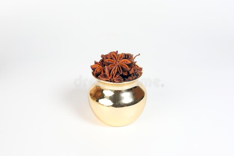 Star anise spice in shiny metal pot royalty free stock photos