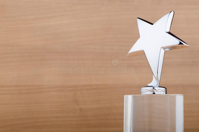 Download Star Award On Wooden Background Stock Photo - Image: 22992766