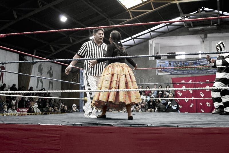 Star cholita female wrestler fighting with the ref. October 14, 2012, El Alto, La Paz, Bolivia stock images