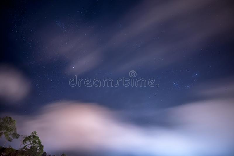 Star Cluster in the night sky with cloudy and windy weather. Traveling in Thailand stock photos