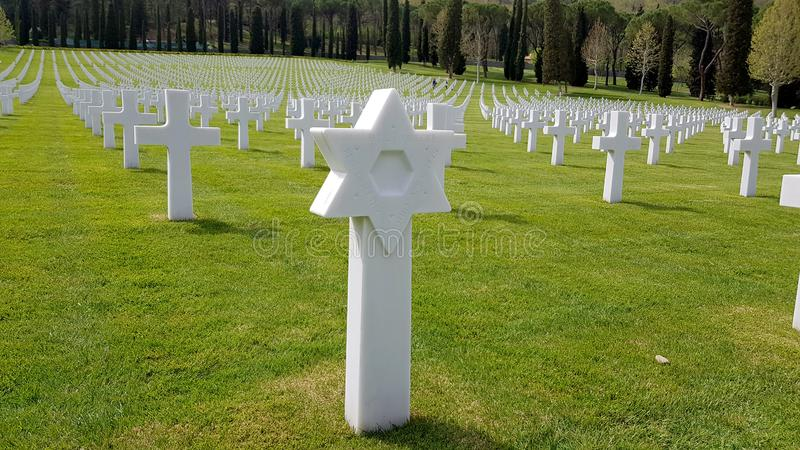 A star of David and the crosses of American soldiers who died during the Second World War buried in the Florence American Cemetery royalty free stock photography