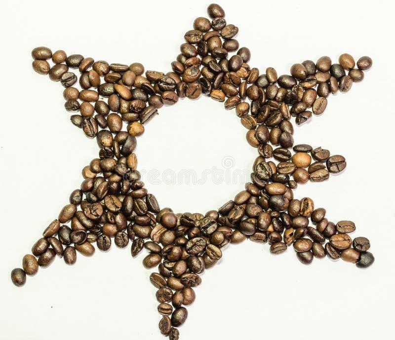 Star dos feijões de café em um fundo branco fotos de stock royalty free