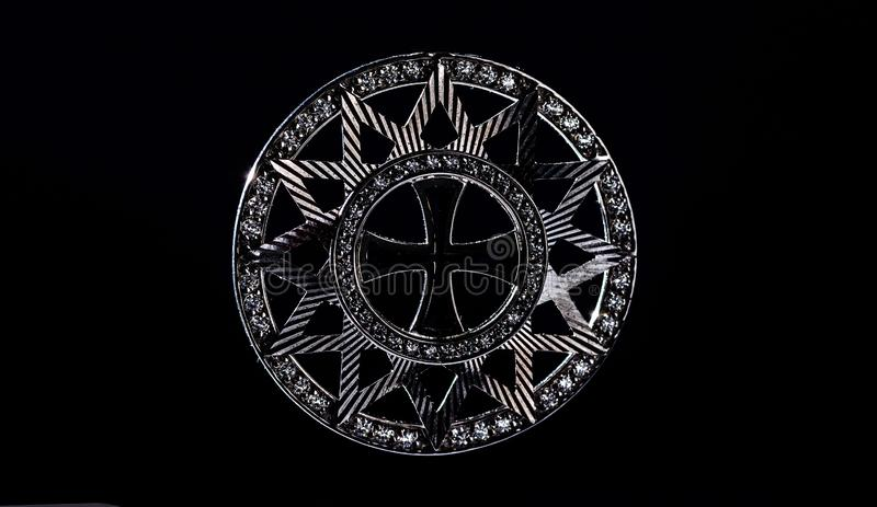 The star of Ertsgamma. Silhouette on a black background. Ancient Christian symbol stock photo