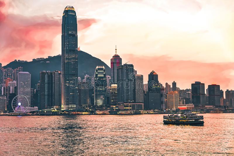 Star ferry at Victoria Harbor Hong Kong skyline at sunset. View from Kowloon on HK Island royalty free stock photos