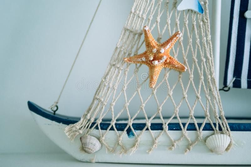 Star fish and net with shell on the boat stock images