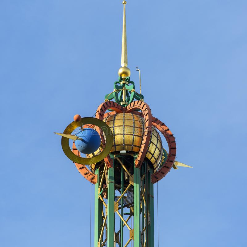 Star Flyer carousel in Amusement Park, Tivoli Gardens, view on the decorative top, Copenhagen, Denmark royalty free stock image