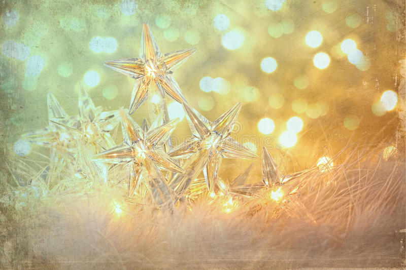 Star holiday lights with sparkle background stock image