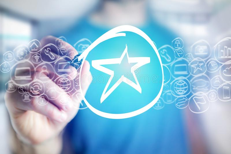 Star icon being drawn by a man on a virtual interface - technology concept. View of a Star icon being drawn by a man on a virtual interface - technology concept royalty free stock images