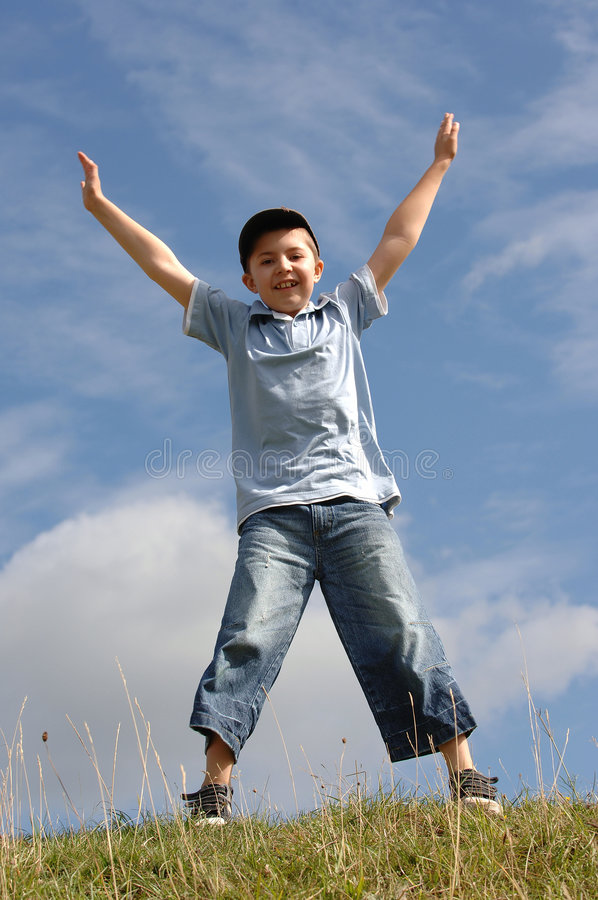 Boy with outstretched arms stock photo